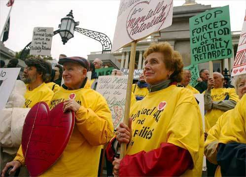 Peggy and Joseph Hughes of Weymouth (center) converged with dozens of other demonstrators in front of the State House in 2005 to protest the planned closing of the Fernald Center. Their son, Brad, at the time had been a resident at the facility for 35 years.