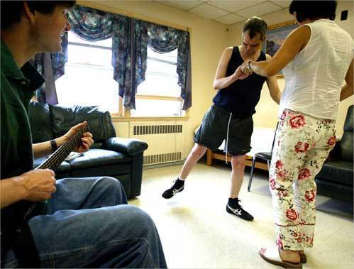 Ronnie Russo (middle) in a music and movement therapy lessons. Ronnie, 51, and twin brother Randy have called Fernald home since age 5.