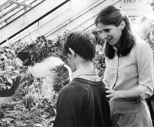 The center evolved over time. Salli Cheek shows a resident in 1982 how to water plants.