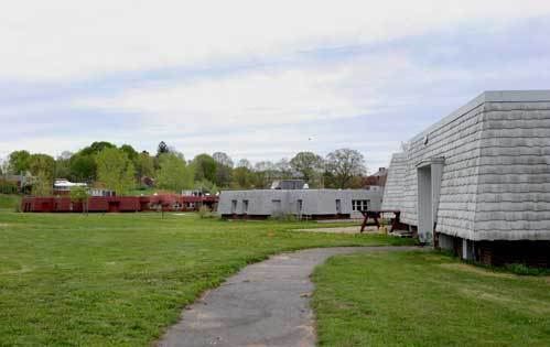 Residential cottages on the grounds. The state intends to relocate the remaining 152 residents and close the center by June 2010.