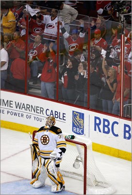 Carolina fans celebrate after Bruins goalie Tim Thomas gave up two goals in the second period.