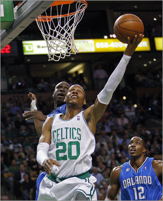 Ray Allen hits reverse layup during the first half in front of Orlando's Rashard Lewis. Dwight Howard (right) could only watch the basket.