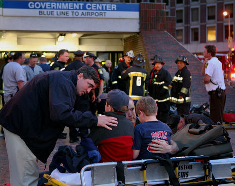 Boston firefighters looked on as two children are consoled outside of the Government Center T stop on Friday night. Read the article.