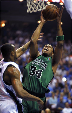 Celtics forward Paul Pierce (right) drove to the basket against Magic forward Rashard Lewis (left) in the first quarter of Game 3 of the series between Boston and Orlando.