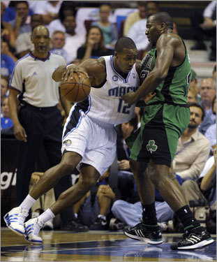 Magic Center Dwight Howard (left) backed down Celtics big man Kendrick Perkins (right) in the first half.