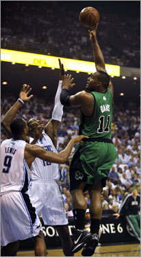 Celtics forward Glen Davis (right) went up for a shot in the paint in the first half.