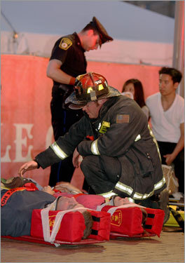 A Boston firefighter tended to a crash victim outside the Government Center station. Read the article.