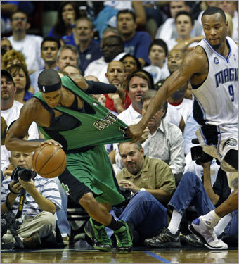 Celtics point guard Rajon Rondo (left) had his jersey held by Magic forward Rashard Lewis (right) in the first half.