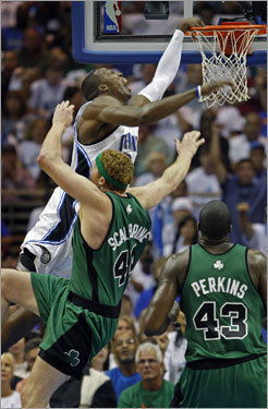 Magic center Dwight Howard (left) was fouled by Celtics forward Brian Scalabrine (44) in the first half.