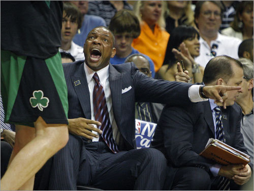 Celtics coach Doc Rivers (center) yelled for a substitution during first half action.