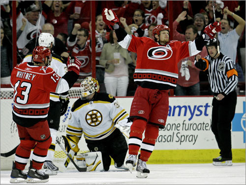 The Hurricanes' Eric Staal (right) celebrated his goal as Bruins goalie Tim Thomas (center) looked on during the first period of Game 4 of the Eastern Conference semifinal series.
