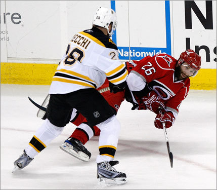 Bruins winger Mark Recchi (left) took down the Hurricanes' Erik Cole (right) in the first period.