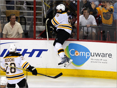 Bruins center Mark Savard (91) celebrated after scoring in the second period.