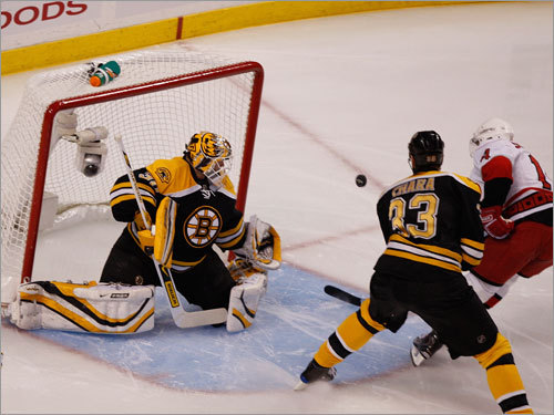 Canes left wing Sergei Samsonov (right) got a shot off against Bruins goalie Tim Thomas (left) during the first period.