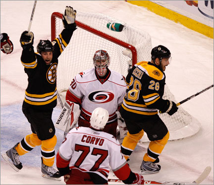 Bruins center Marc Savard (left) celebrated a goal by Bruins right win Mark Recchi (right) in the first period.