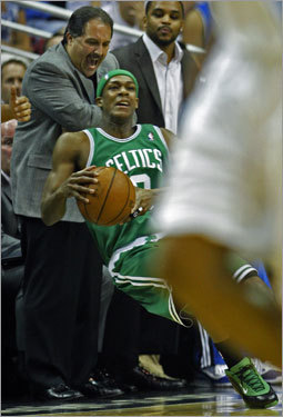 Rajon Rondo reacted after being pushed out of bounds in the first half.