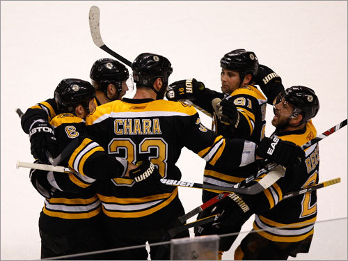 Bruins captain Zdeno Chara (33) celebrated with teammates after the goal by Mark Recchi (right) in the first period.