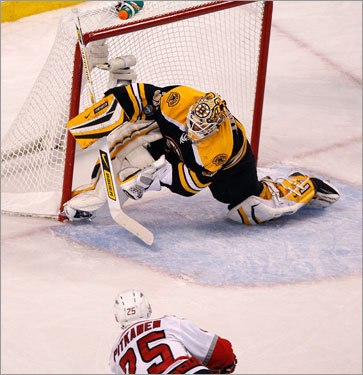 Bruins goalie Tim Thomas made a spectacular save on a rebound attempt from Hurricanes defenseman Joni Pitkanen (25) in the first period.