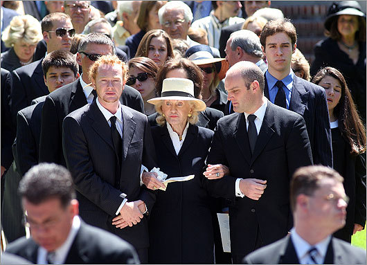 DiMaggio's grandson, Alex, accompanied his grandmother, Emily, as they followed the casket outside.