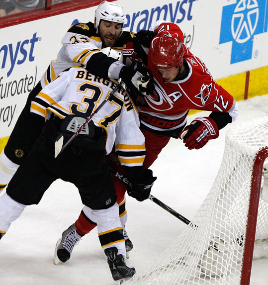 Bruins defenseman Zdeno Chara (33) drew a penalty for this hit on Hurricanes center Eric Staal (12) late in the first period.
