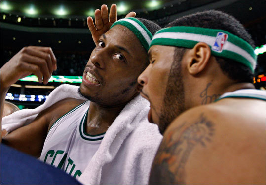 Boston's Paul Pierce, left, and Eddie House conference on the bench during a timeout.