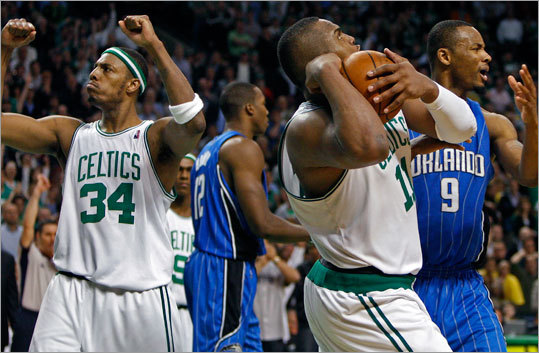 Paul Pierce (34) pumps his fists as Glen 'Big Baby' Davis (11) draws a late foul. Davis iced the game with the free throws.