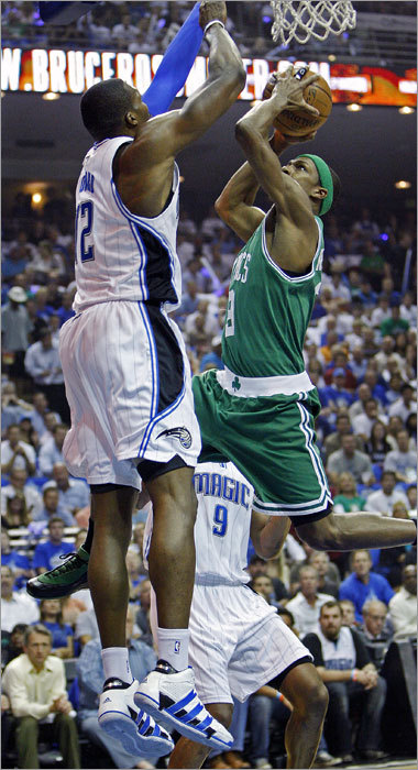 Rajon Rondo was met at the rim by Orlando's Dwight Howard in the first half.