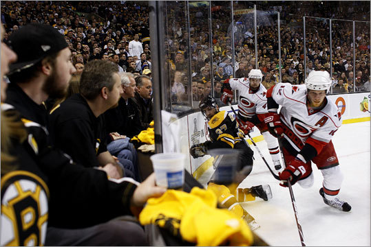 Patrice Bergeron was ganged up on by Carolina Hurricanes players Eric Staal and Dennis Seidenberg.