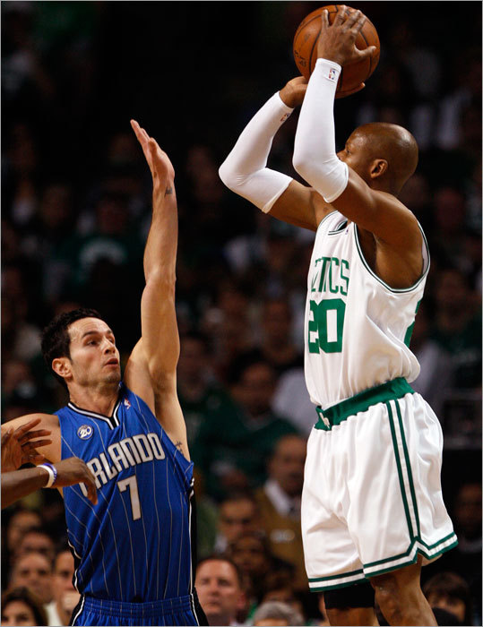 Boston's Ray Allen (20) shoots a jumper over Orlando's J.J. Redick (7).