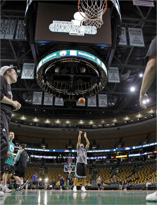 Eddie house shoots free throws before Game 7, while the JumboTron displays an image celebrating the Celtics at 2008 World Champions.