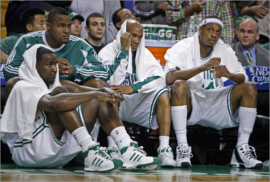 After coach Doc Rivers threw in the towel on the Celtics' season, Kendrick Perkins, Stephon Marbury, and Paul Pierce (left to right) watched the final moments run out in Game 7.