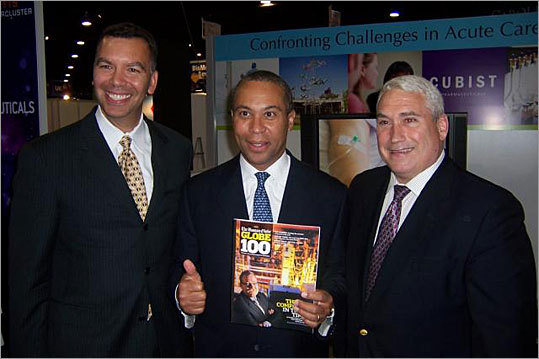 Massachusetts Governor Deval Patrick celebrates Cubist Pharmaceuticals' spot atop the Globe 100 with Robert J. Perez, Cubist's executive vice president and chief operating fficer (left) and Steven C. Gilman, Cubist's senior vice president or discovery and nonclinical development and chief scientific officer.