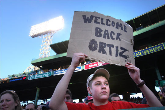 Sean Konieczny of Dudley holds a sign supporting David Ortiz during the first inning. Ortiz returned to the lineup Tuesday night after sitting out the final three games of Boston's West Coast road trip. Ortiz is still looking for his first homer of the season.