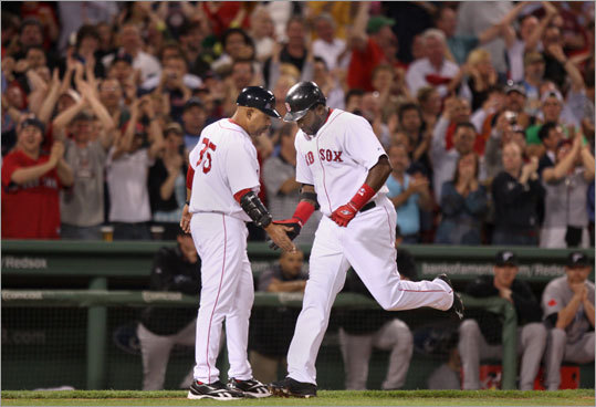 Third base coach DeMarco Hale congratulates Ortiz, who said after the game, 'I feel like I got my confidence back.'