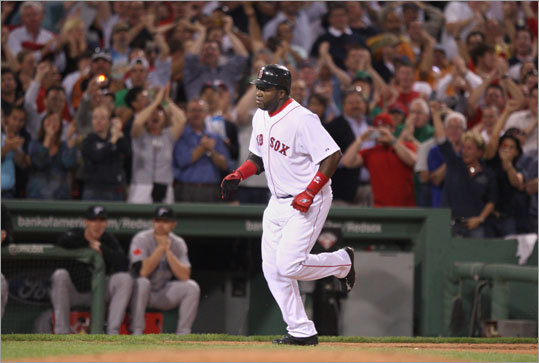 Ortiz rounds third base as the crowd roars following his two-run home run.