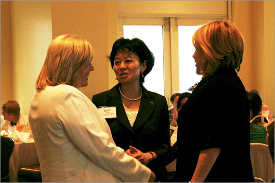 Honoree Deirdre Buckley talks with Judge Lin Zhan and guest.