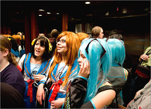 In character: From left, Sydney Lewis and Alex Revaleon (as Haruhi and Mikuru from 'The Melancholy of Haruhi Suzumiya' series), and Angelese Revaleon (as a Vocaloid).