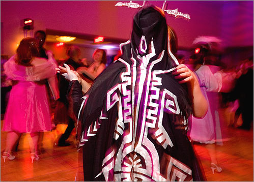 Dawn Conway of Peterborough, N.H. (dressed as Midna from the Zelda game 'Twilight Princess'), taught a partner the promenade.
