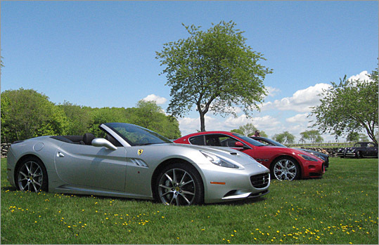 The Ferrari California and two Maseratis sit in a field on Sakonnet Vineyards.
