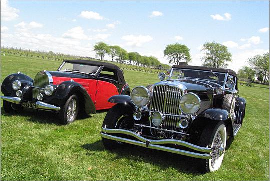 A rare moment: a classic Bugatti, and a Dusenberg.