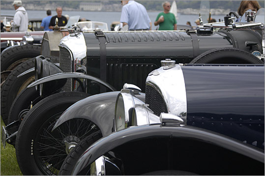 Two Bentleys line the foreground; a fire engine-powered racer, Frazer Nash, and Alfa Romeo are behind.