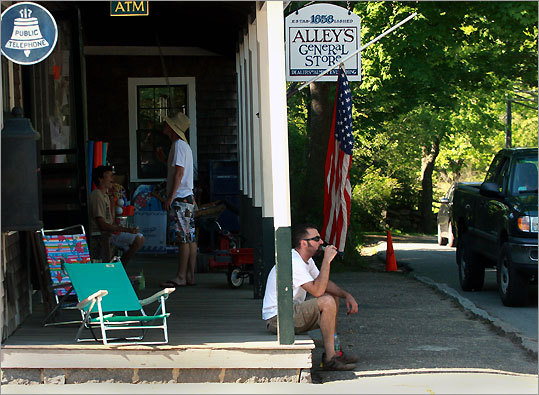 Vacationer Anthony Patricco of N.J. sips a Coke on the front porch of Alley's General Store on State Rd. in West Tisbury. The store is over 150 years old
