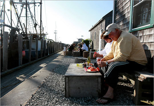 Elliot and Ellie Soltz of Longmeadow eat a dinner of boilled lobster and a bottle of wine in back of Larsen's Fish Market in Menemsha, where they bought the boiled lobster.