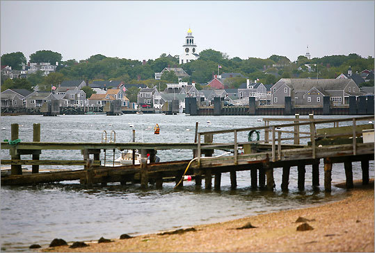 A view of the shore across the harbor from the Brant Point Light on Nantucket Island.