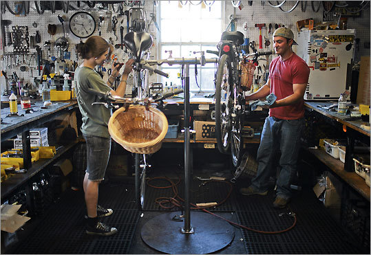 Abbey Carr and Tom Holt repair rental bikes at Young's Bicycle Shop on Nantucket Island.