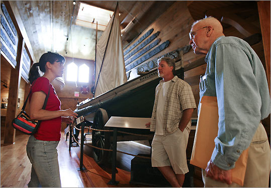 Beth Roberts (left) and her husband Keith Roberts (center), of Pennsylvania, talk with tour guide Dick Mack at the Ship Wreck and Lifesaving Museum on Nantucket Island.
