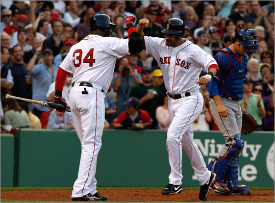 Upon review by the umpires, Lowell's blast was called a homer, which put the Red Sox up, 1-0. He was congratulated at home plate by David Ortiz, who hit his second homer of the season later in the game.
