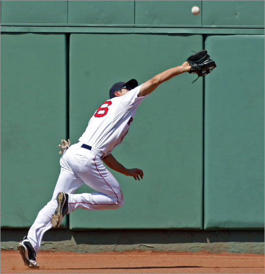 Red Sox centerfielder Jacoby Ellsbury made a nice running catch to rob the Rangers Ian Kinsler of a hit for the last out of the top of the fourth inning, but his momentum carried him toward the wall, and he stopped his fall by putting his arms out and landing awkwardly.