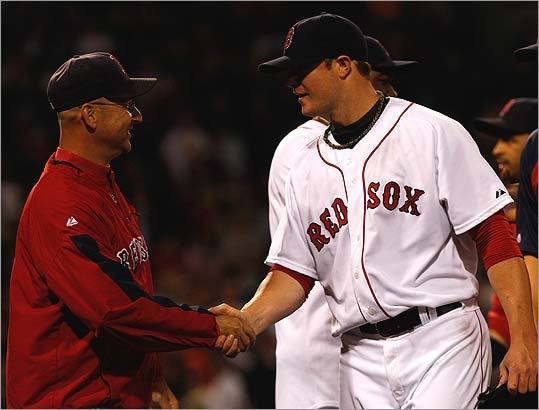 Manager Terry Francona (left) and Jon Lester