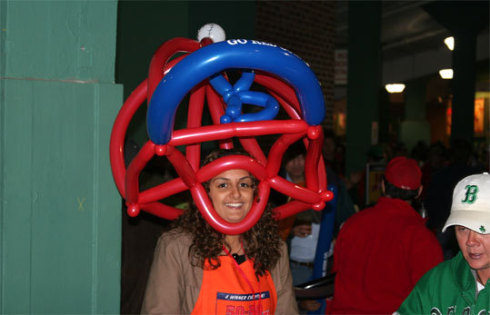 We're not sure if the balloon hat was the right attire to keep your head dry at Fenway Park on a rainy Tuesday night.